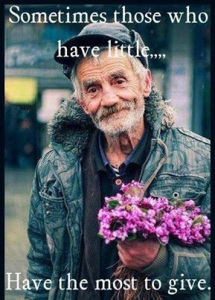 Photo of a Homeless Man Holding Purple Flowers