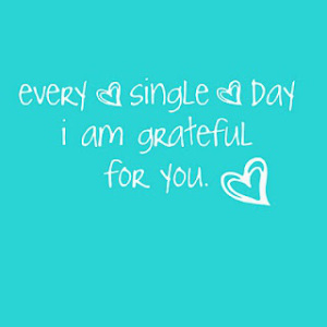 Light Blue Background With A Gratitude Quote in White Writing With A Heart