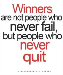Quote About Winning In Red Ink on A White Background
