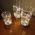 3 White Lights In Glass Cannisters